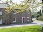 CORNER COTTAGE, stone-built, end-terrace, character features, woodburner, enclosed lawned garden, in Great Strickland, Ref 905605