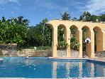 Water spills over the aqueduct into the swimming pool