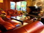 leather couches and stone fireplace in the living room. fantastic entertaining space.
