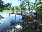Upper and lower levels of the patio, with boat dock and jet ski ramp for watersports