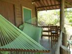 Second level balcony - hammock, table and a couple of high chairs to enjoy the view