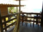 Main bedroom porch hammock and high table/chairs