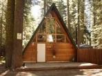 Tahoe A-Frame Rustic Cabin in forest setting