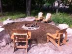 Our private firepit with adirondack chairs and boulders - just steps from Woodland Valley Stream