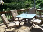 Back Deck with patio set including 4 chairs.  Other folding chairs available