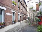 a charming propery built in 1800, with a flowered courtyard