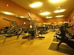 24hr, 800 sq foot, fully equipped fitness center w/ Flat screen TVs on wall