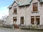 PENDLETON COTTAGE, stone-built, open fire, WiFi, enclosed gardens, close to excellent amenities, in Grange-over-Sands, Ref 28327