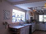 Partial view of Kitchen - sink and ceramic stove top