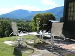 Summer dining al fresco at the innkeeper's cottage with a BBQ and best views in VT.