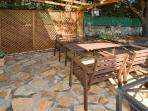 Private patio area with table, chairs and BBQ