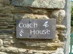 The Cottage Sign on the wall by the gate to the cottage's private patio