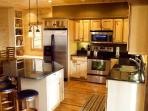 Stainless Steel Appliances in a Fully Stocked Kitchen
