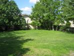 View across the garden towards the cottage. Badminton & boules equipment provided.