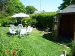 garden with patio chairs & summerhouse
