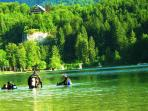 Bohinj lake in summer,with divers