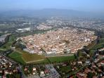 Picturesque city of Lucca, seen from above surrounded by its 16th Walls