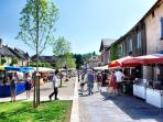 Market day at Place du Fauborg - the central square and hub of this medieval bastide village