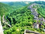 Picturesque village of Najac stretches along a ridge with the Aveyron River winding below