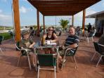 On the terrace at the Golf bar. Quiz nights, Paella evenings and more.