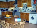 Fully equipped kitchen with huge table, designed with long lovely meals in mind with friends