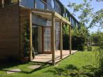 Covered entrance and sun trap patio
