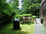 Outdoor with seating for 5 and charcoal BBQ