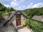 The patio at Mill Barn has stunning views over the Wray River Valley and into the village