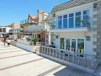 Nicely decorated upper oceanfront unit- near amenities, rooftop deck, w/d