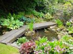 Our walled rose garden has a pretty pond, bird feeder and sun terrace with seating.