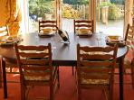 dining room, bi-fold doors in the background leading to deck area