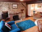 Lounge with real log fire and flat screen TV