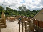 Decked area with garden furniture and barbecue