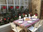 Dine out in the courtyard by candlelight