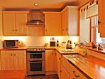 Very high specification modern kitchen, with breakfast bar