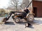 The farmer, his dog and his tractor