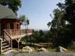 Multi-level log home with natural spring on property, great view, sleeps 10
