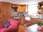 Bespoke pine fitted units, granite work top and Belfast sink,