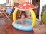 Our son enjoying the paddling pool and outdoor dining area