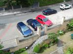 Parking in front of the building and shared garden
