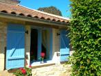 Painted shutters lend a French rustic feel to Garden Cottage