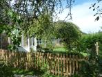 Fenced private garden; access to communal gardens, paddock and large trampoline with enclosure