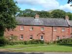A traditional Westmorland Longhouse on a quiet village green, nestled below the Pennine hills