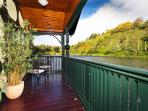 Relax on the balcony overlooking your own private loch