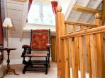 Victorian rocking chair on landing with dormer window behind, ideal place to sit and read
