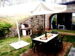 Outside covered eating area with bbq