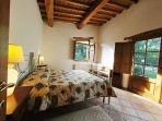 Twin/double bedroom on the upper floor, with access to the above terrace.
