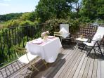 Dining on the terrace with views across the valley