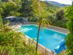 heated swimming pool and seating area