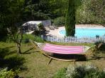 The hammock for snoozing and keeping an eye on the pool